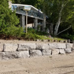large rock wall, excavation services